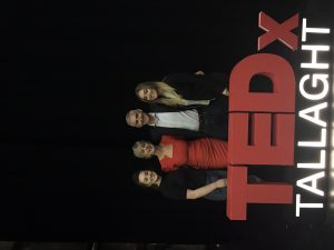 Barbara and family with TEDx signage